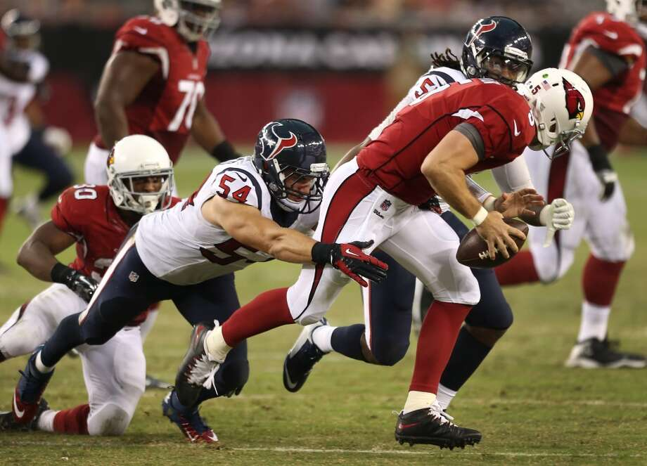 Houston Texans linebackers Mike Mohamed (54) and Justin Tuggle (57) chase Arizona Cardinals quarterback Drew Stanton (5) out of the pocket during the second quarter of an NFL pre-season football game at University of Phoenix Stadium Saturday, Aug. 9, 2014, in Glendale, Ariz. ( Brett Coomer / Houston Chronicle ) Photo: Brett Coomer, Houston Chronicle
