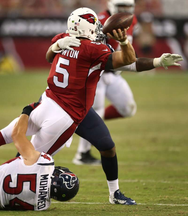 Houston Texans linebacker Mike Mohamed (54) hits Arizona Cardinals quarterback Drew Stanton (5) as he releases the football during the second quarter of an NFL pre-season football game at University of Phoenix Stadium Saturday, Aug. 9, 2014, in Glendale, Ariz. ( Brett Coomer / Houston Chronicle ) Photo: Brett Coomer, Houston Chronicle