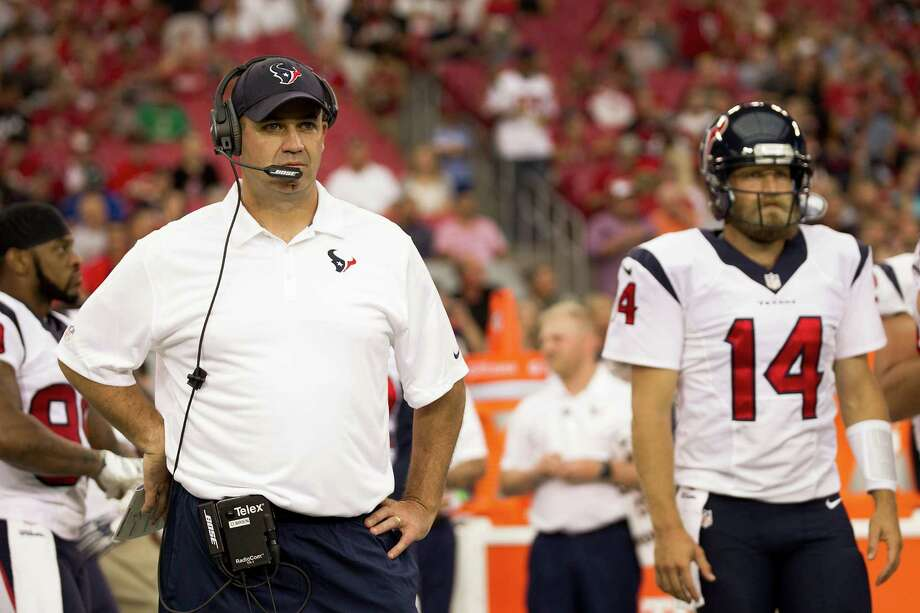 Texans coach Bill O'Brien, left, and quarterback Ryan Fitzpatrick could do little but watch Saturday night's one-sided preseason opener unfold. Fitzpatrick went 6-of-14 for 55 yards and two interceptions in the 32-0 loss. Photo: Brett Coomer, Staff / © 2014  Houston Chronicle