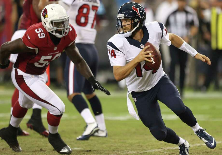 Texans QB Ryan Fitzpatrick is chased by Cardinals linebacker Marcus Benard in the second quarter. Fitzpatrick played the first half, completing six of 14 attempts for 55 yards and two picks. Photo: Brett Coomer, Staff / © 2014  Houston Chronicle