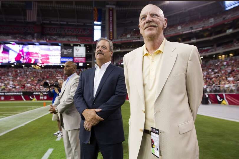 Houston Texans owner Bob McNair, right, watches the first quarter of an NFL pre-season football game