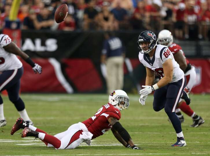 The football flies away from Houston Texans tight end Garrett Graham (88) and over Arizona Cardinals