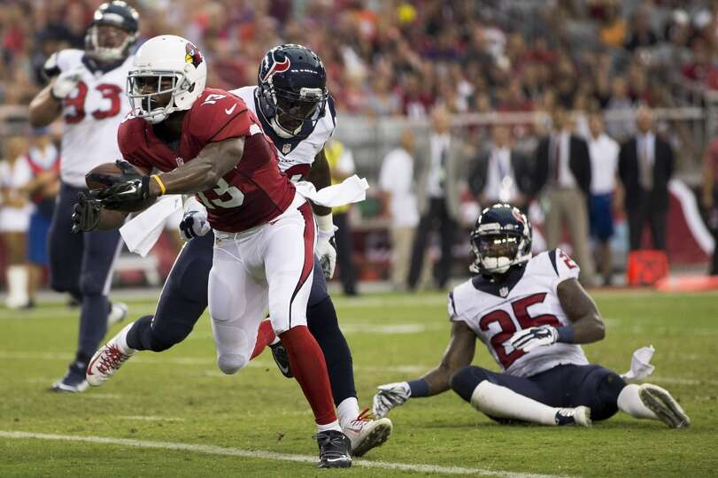 Arizona Cardinals wide receiver Jaron Brown (13) breaks away from Houston Texans strong safety Chris
