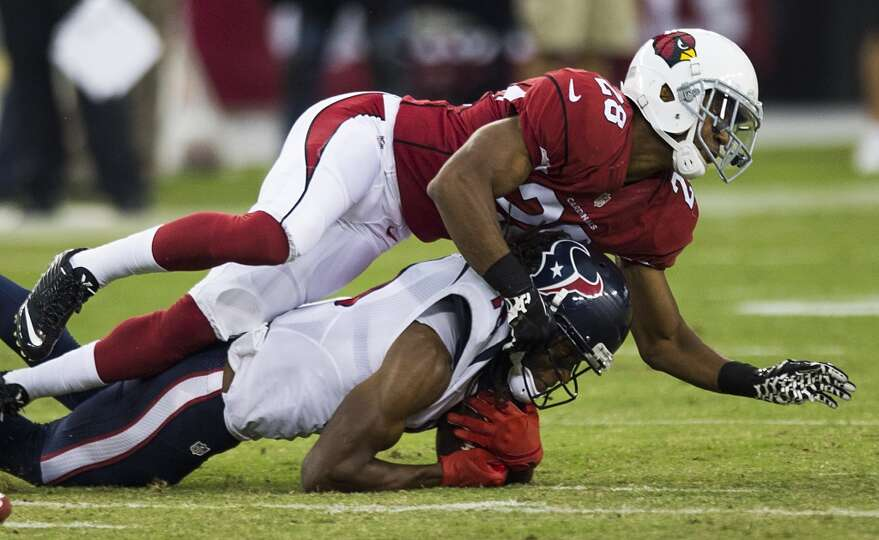 Arizona Cardinals cornerback Justin Bethel (28) stops Houston Texans wide receiver DeAndre Hopkins (