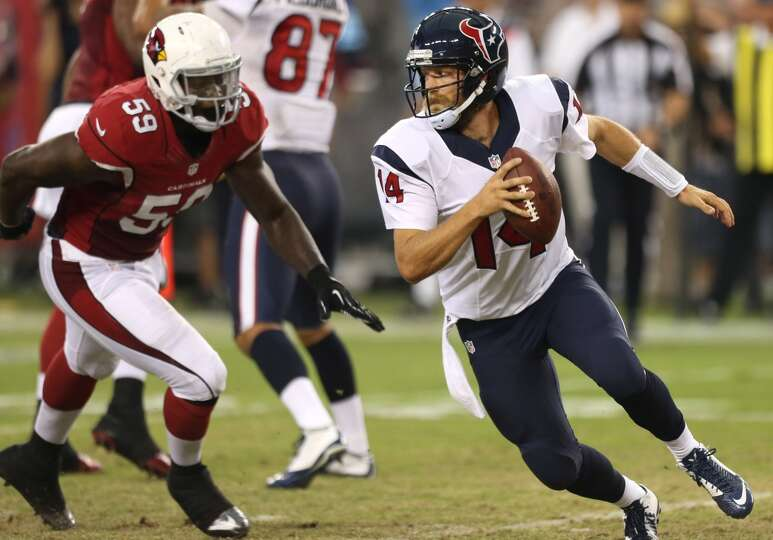 Houston Texans quarterback Ryan Fitzpatrick (14) is chased out of the pocket by Arizona Cardinals li