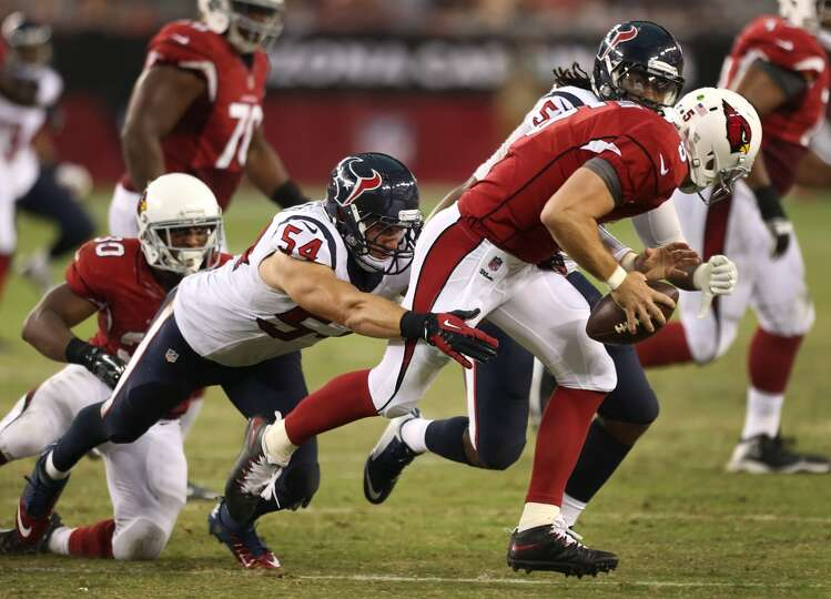 Houston Texans linebackers Mike Mohamed (54) and Justin Tuggle (57) chase Arizona Cardinals quarterb
