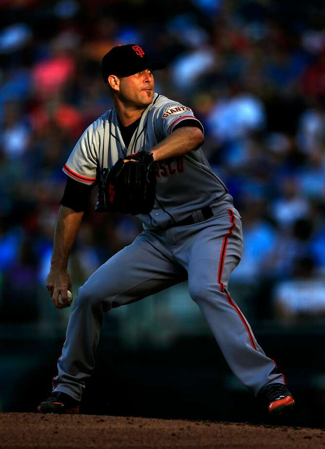 Tim Hudson couldn't escape the shadows of the Giants' flailing offense. Photo: Jamie Squire, Getty Images