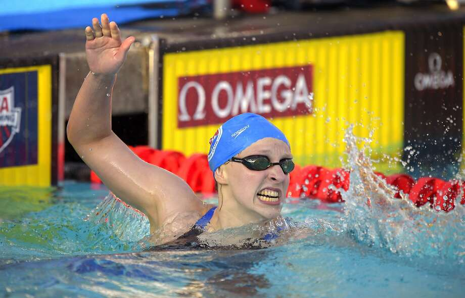 Katie Ledecky can't contain her excitement after breaking a 5-year-old world record. Photo: Mark J. Terrill, Associated Press