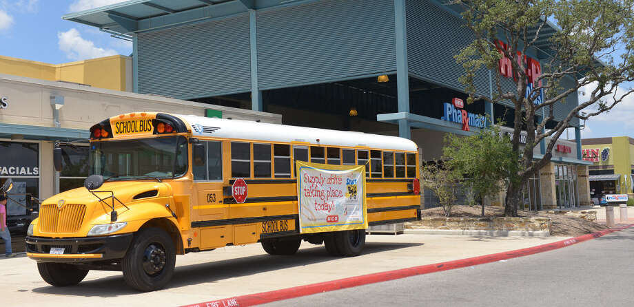 A Northside Independent School District bus is parked in front of the H-E-B at U.S. 281 and Evans Road for the Stuff the Bus school supplies drive. Twenty-four H-E-B stores participated. Photo: Robin Jerstad / For The San Antonio Express-News