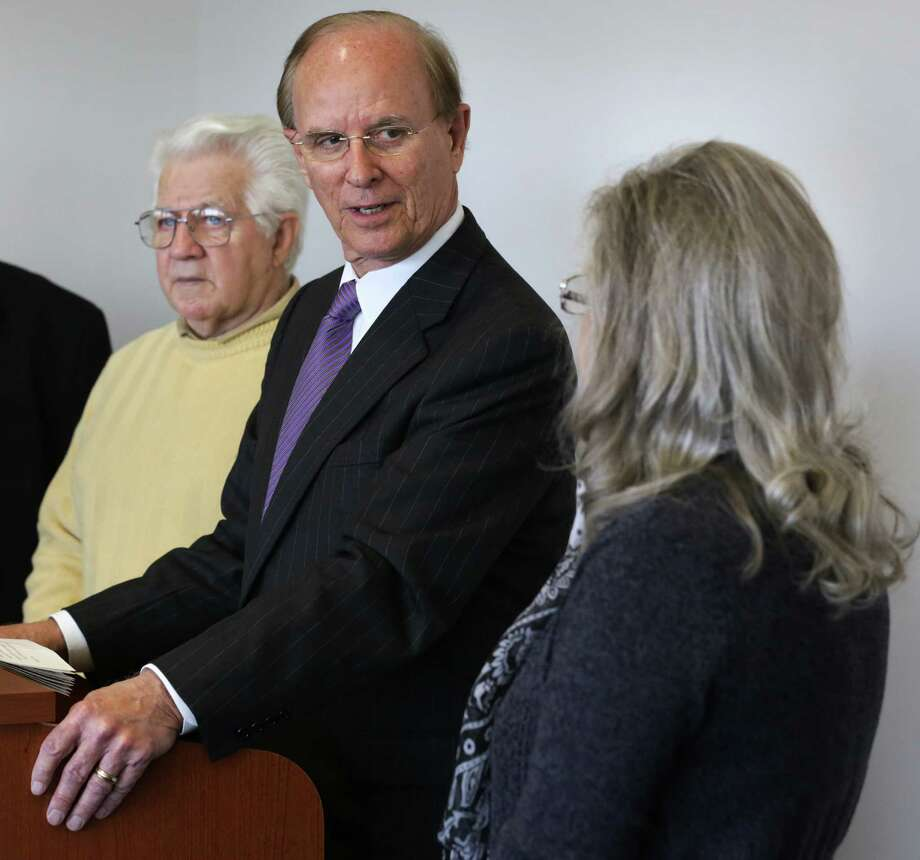 Members of the Committee to Incorporate City of Sandy Oaks, Charlotte Rabe (right) and Jim Clement (left), listen as Bexar County Judge Nelson Wolff announces the committee's filing to become a city in January. Clement was elected the new city's first mayor on Saturday. Photo: BOB OWEN, San Antonio Express-News / © 2012 San Antonio Express-News