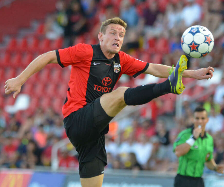 The Scorpions' Tomasz Zahorski, who scored in the 28th minute, stretches for the ball at Toyota Field. Photo: Robin Jerstad / For The Express-News