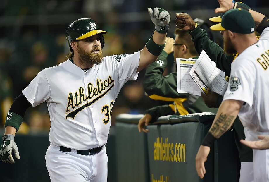 OAKLAND, CA - AUGUST 09:  Derek Norris #36 of the Oakland Athletics is congratulated by teammates after he hit a three-run homer against the Minnesota Twins in the bottom of the six inning at O.co Coliseum on August 9, 2014 in Oakland, California.  (Photo by Thearon W. Henderson/Getty Images) Photo: Thearon W. Henderson, Getty Images