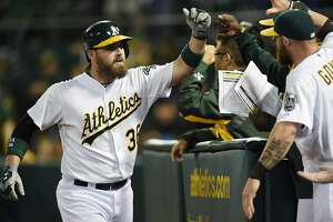 A's trade Norris for 2 pitchers - Photo