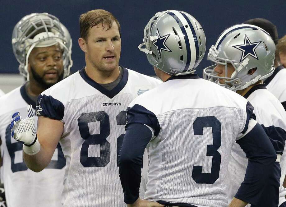 Tight end Jason Witten (82), talking to QB Brandon Weeden (3), relishes the chance to lead a young roster. Photo: LM Otero / Associated Press / AP