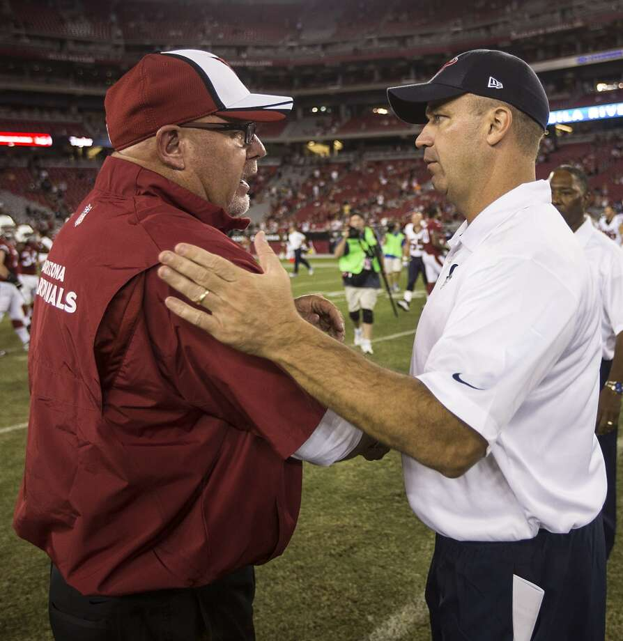 Arizona Cardinals head coach Bruce Arians, left, and Houston Texans head coach Bill O'Brien shake hands following of an NFL pre-season football game at University of Phoenix Stadium Saturday, Aug. 9, 2014, in Glendale, Ariz. ( Brett Coomer / Houston Chronicle ) Photo: Brett Coomer, Houston Chronicle