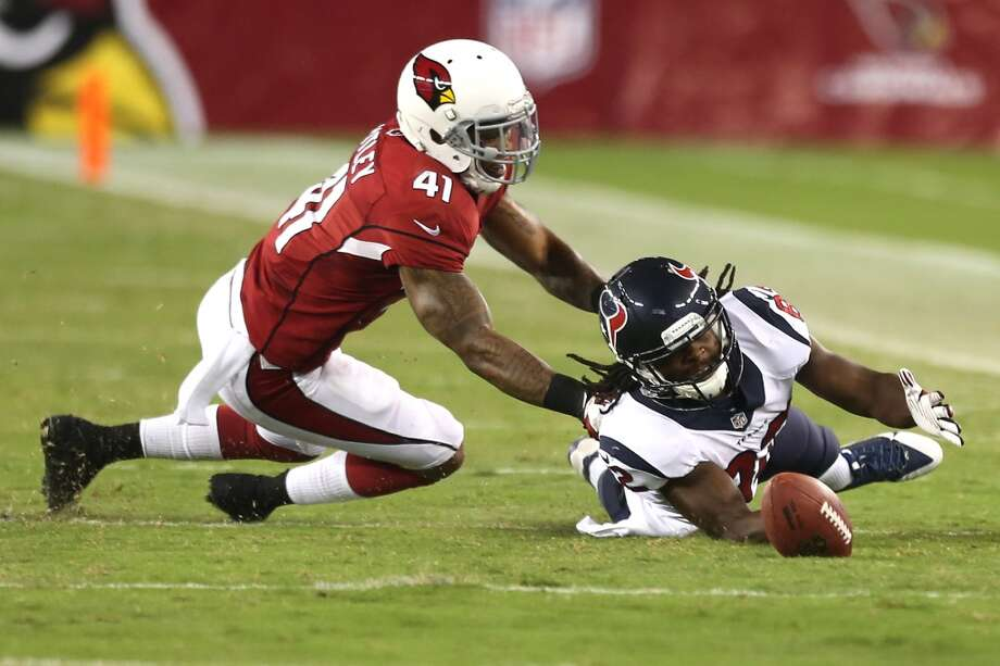 Houston Texans wide receiver Keshawn Martin (82) dives in vain for a ball in the grass as he is covered by Arizona Cardinals defensive back Eddie Whitley (41) during the fourth quarter of an NFL pre-season football game at University of Phoenix Stadium Saturday, Aug. 9, 2014, in Glendale, Ariz. ( Brett Coomer / Houston Chronicle ) Photo: Brett Coomer, Houston Chronicle