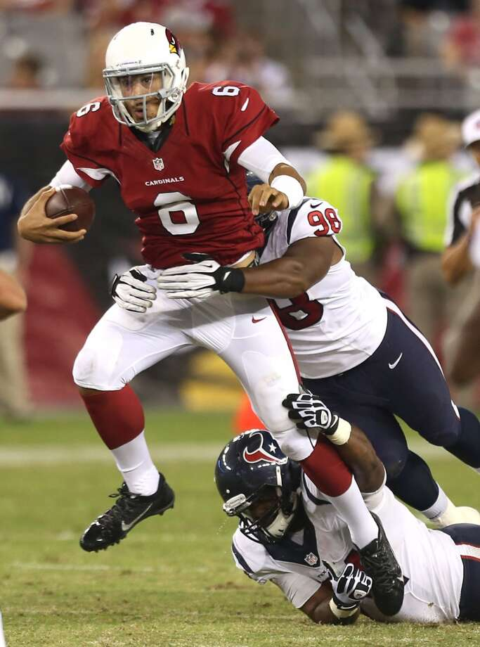Arizona Cardinals quarterback Logan Thomas (6) is tackled by Houston Texans defensive end Keith Browner (98) and defensive end Julius Warmsley (74) as he scrambles from the pocket during the fourth quarter of an NFL pre-season football game at University of Phoenix Stadium Saturday, Aug. 9, 2014, in Glendale, Ariz. ( Brett Coomer / Houston Chronicle ) Photo: Brett Coomer, Houston Chronicle
