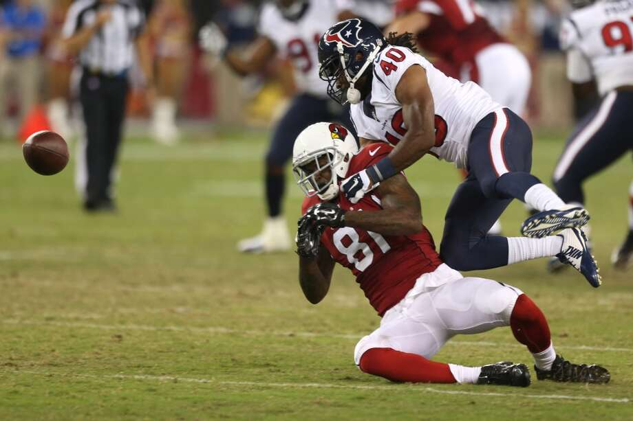 Houston Texans defensive back Marcus Williams (40) breaks up a pass intended for Arizona Cardinals wide receiver Dan Buckner (81) during the fourth quarter of an NFL pre-season football game at University of Phoenix Stadium Saturday, Aug. 9, 2014, in Glendale, Ariz. Williams was called for a penalty on the play. ( Brett Coomer / Houston Chronicle ) Photo: Brett Coomer, Houston Chronicle