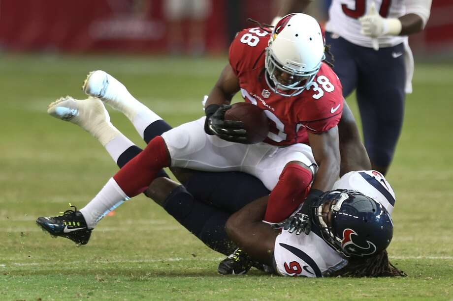 Houston Texans linebacker Jadeveon Clowney (90) tackles Arizona Cardinals running back Andre Ellington (38) during the first quarter of an NFL pre-season football game at University of Phoenix Stadium Saturday, Aug. 9, 2014, in Glendale, Ariz. ( Brett Coomer / Houston Chronicle ) Photo: Brett Coomer, Houston Chronicle