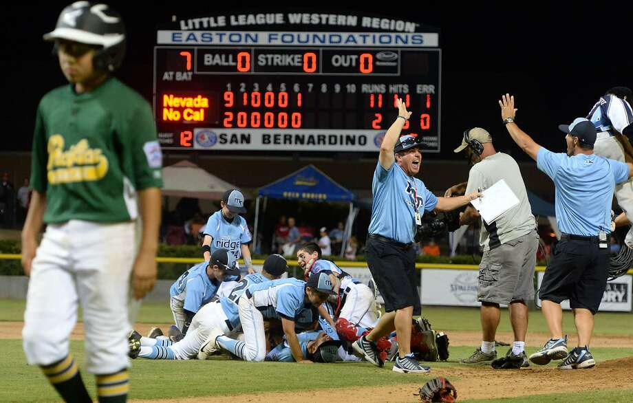 Mountain Ridge, Nev., players celebrate their victory over Pacifica American in the Little League West Region final. Photo: Will Lester, Associated Press