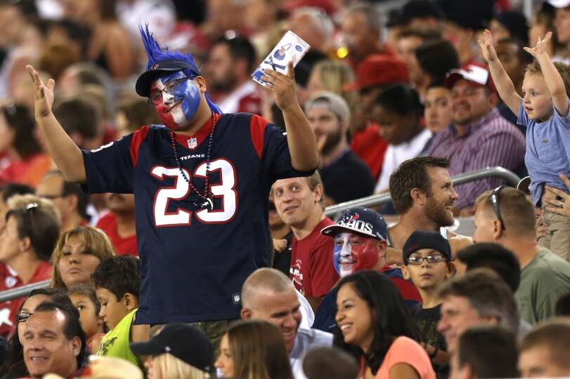 A Houston Texans fan reacts to the Texans blowout loss to the Arizona Cardinals during the fourth qu
