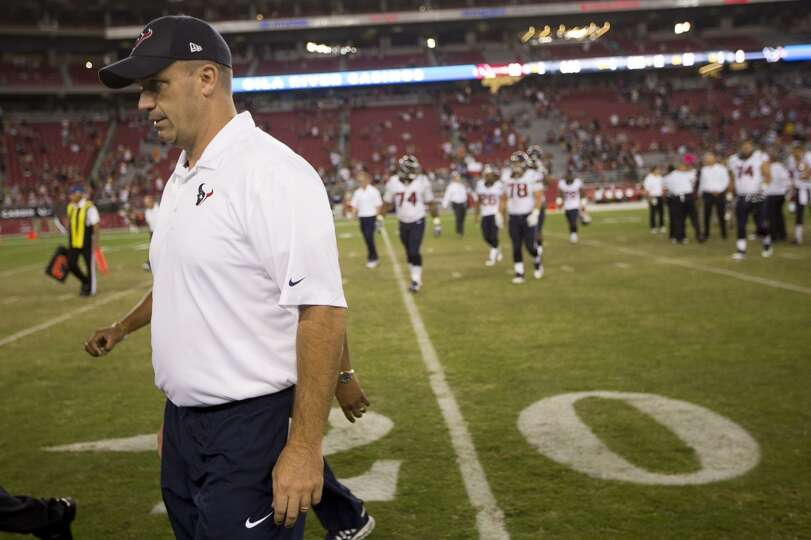 Houston Texans head coach Bill O'Brien walks off the field after the Texans 32-0 loss to the Arizona