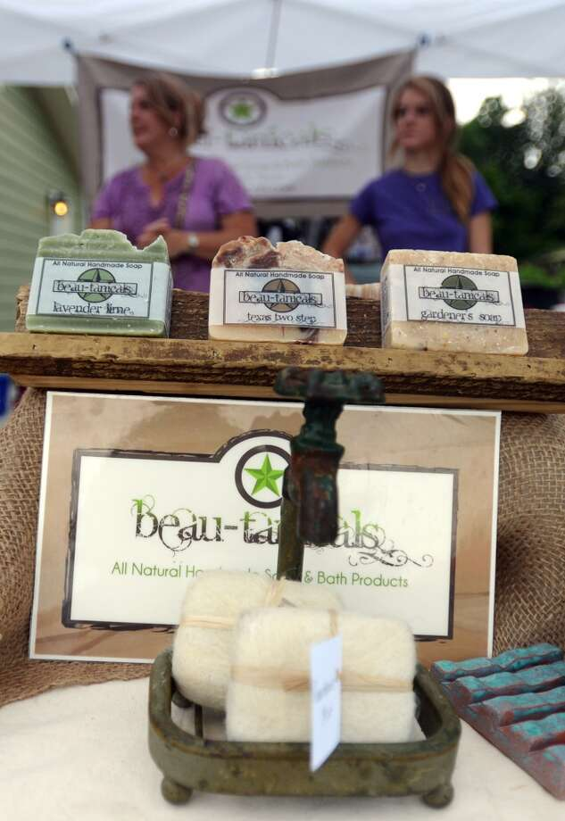 Soaps and other natural goods are displayed at the Beau-tanicals booth during the Down to Earth farmers market Tuesday. Down to Earth, a Nederland shop that specializes in locally produced natural and organic items, has launched a Tuesday afternoon farmers market in their parking lot. Photo taken Tuesday 7/22/14 Jake Daniels/@JakeD_in_SETX
