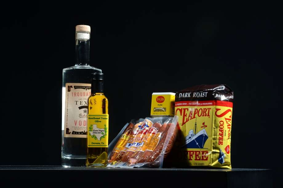 Texas Vodka, Southeast Texas Olive Oil, Zumos sausages, Tex Joy spices and Seaport Coffee. Photo taken Thursday, July 31, 2014 Guiseppe Barranco/@spotnewsshooter
