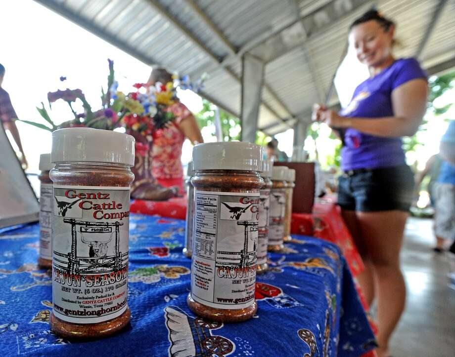 Gentz Cattle Company both is set up at the Beaumont Farmers Market every Saturday offering a selection of meats and seasonings.  Photo taken Saturday, July 6, 2013. Photo taken: Randy Edwards/The Enterprise