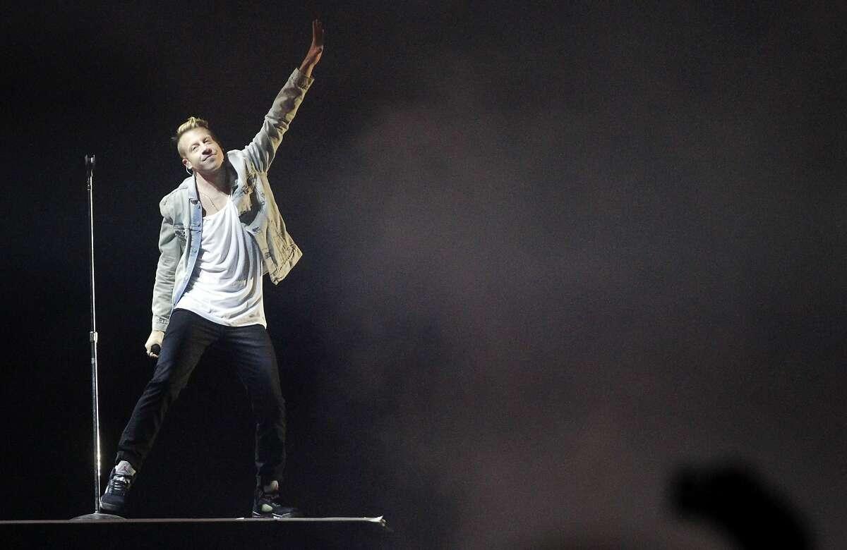 Macklemore performs during Outside Lands music festival August 9, 2014 in Golden Gate Park in San Francisco, Calif.