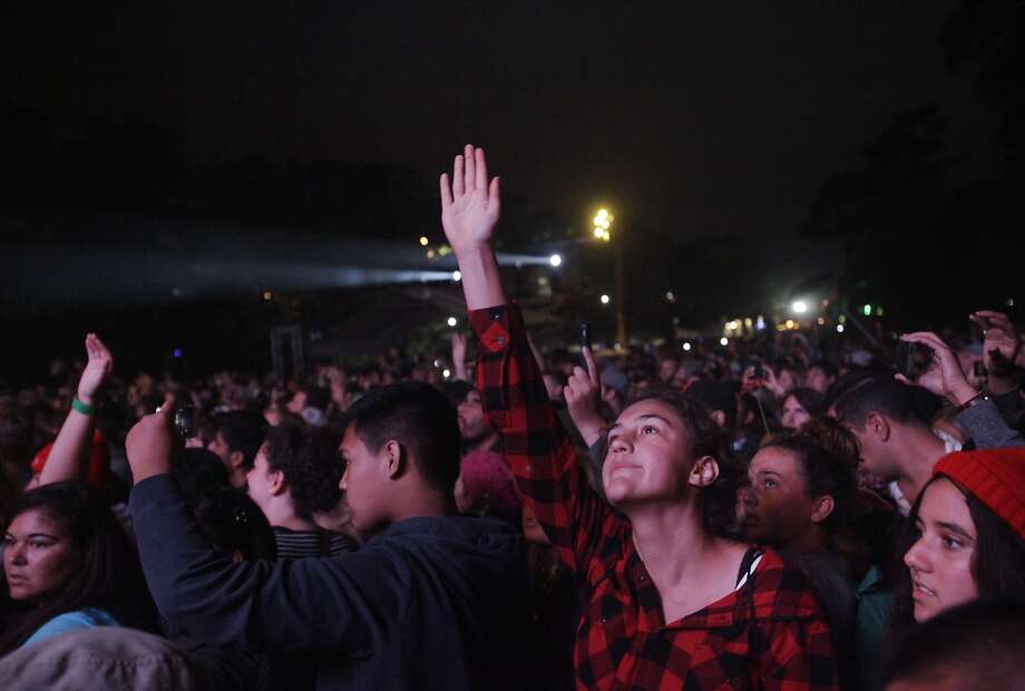 Fans respond to Macklemore as he performs with Ryan Lewis during Outside Lands music festival August 9, 2014 in Golden Gate Park in San Francisco, Calif. Photo: Leah Millis, The Chronicle