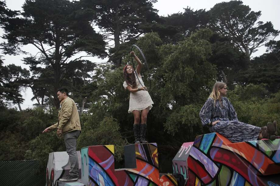 From left, Chris Weiskrack, 25, Audrey Halu, 23, and Hannah Harris, 26, play on scuptures during Outside Lands music festival August 9, 2014 in Golden Gate Park in San Francisco, Calif. Photo: Leah Millis, The Chronicle