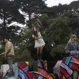 From left, Chris Weiskrack, 25, Audrey Halu, 23, and Hannah Harris, 26, play on scuptures during Outside Lands music festival August 9, 2014 in Golden Gate Park in San Francisco, Calif.