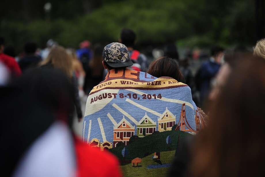 A couple walk toward the entrance of Outside Lands Music Festival in Golden Gate Park on August 09, 2014 in San Francisco, CA. Photo: Craig Hudson, The Chronicle