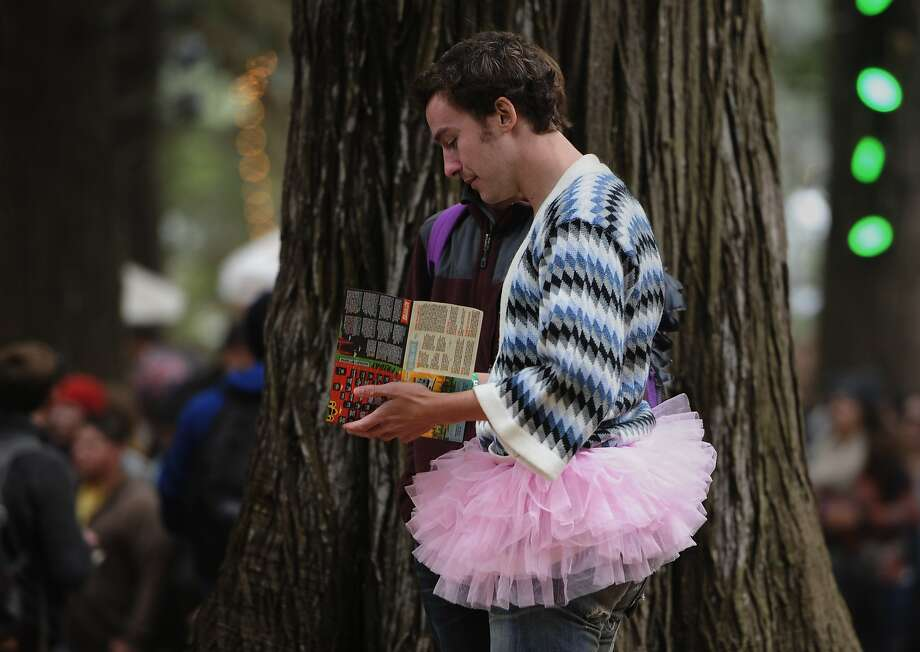A tu-tu wearing man looks at a map during the Outside Lands Music Festival in Golden Gate Park on August 09, 2014 in San Francisco, CA. Photo: Craig Hudson, The Chronicle