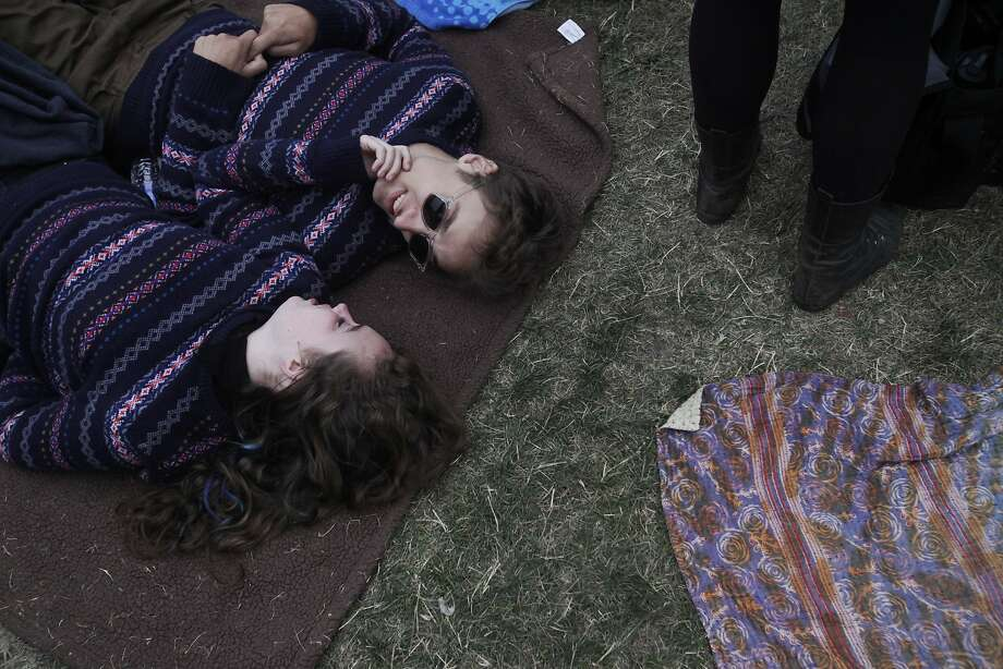 Savannah Grunden, 17, left and Alejandro Clark, 19, lay together in unplanned matching sweaters as Death Cab For Cutie performs during Outside Lands music festival August 9, 2014 in Golden Gate Park in San Francisco, Calif. Photo: Leah Millis, The Chronicle
