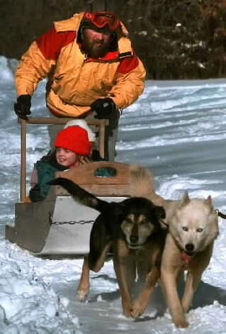 Edgar Morey, in back, is pictured giving a 5-year-old a ride with his huskies Saturday, Jan. 29, 2000, during the 5th Annual Frost Faire at the Saratoga National Park in Stillwater, NY. Morey is believed to be the same gentleman facing attempted murder charges for allegedly trying to kill someone in a Montgomery County nursing home Aug. 9, 2014, Photo by CINDY SCHULTZ