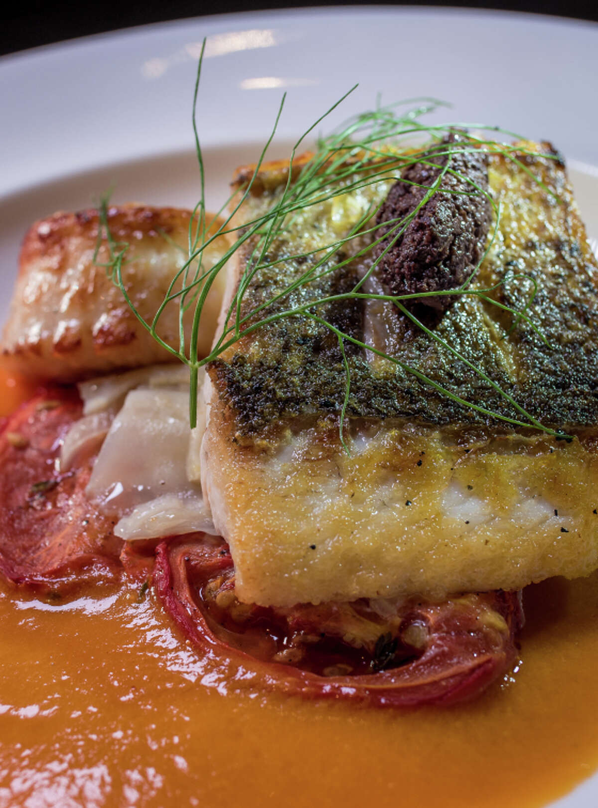 The striped bass and scallop duo at Gaspar in San Francisco.