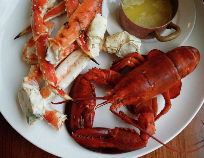 Maine lobster and King crab legs are seen July 31, 2014 at Luke ...