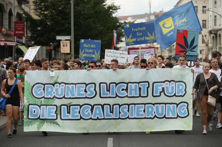 "Participants carrying a banner that reads: ""Green Light For Legalization"" march in the annual Hemp Parade (Hanfparade) on August 9, 2014 in Berlin, Germany. Supporters of cannabis legalization are hoping legalized sale in parts of the USA will increase the likelihood of legalization in Germany. The city of Berlin is considering allowing the sale of cannabis in one city district.  (Photo by Sean Gallup/Getty Images) Photo: Sean Gallup, Getty Images"