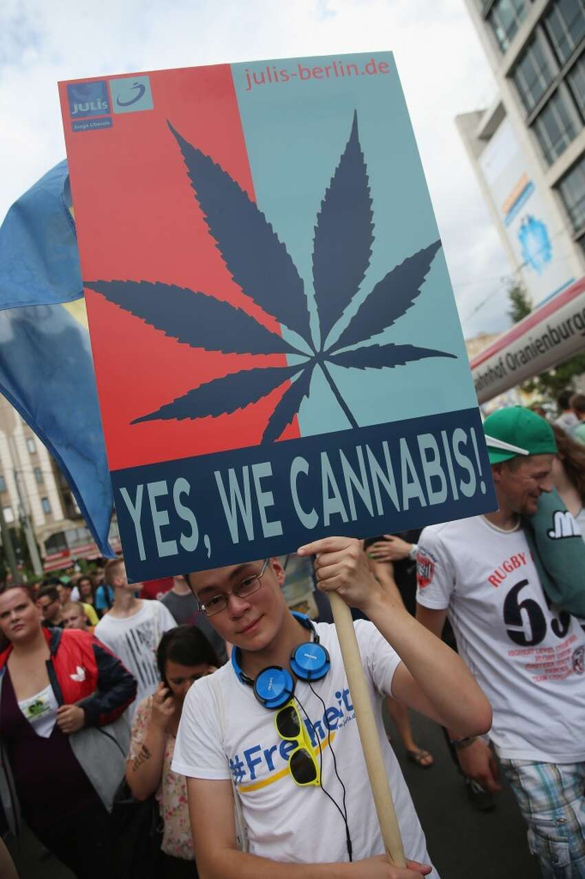 A participant supporting the legalization of marijuana marches in the annual Hemp Parade (Hanfparade) on August 9, 2014 in Berlin, Germany. Supporters of cannabis legalization are hoping legalized sale in parts of the USA will increase the likelihood of legalization in Germany. The city of Berlin is considering allowing the sale of cannabis in one city district. (Photo by Sean Gallup/Getty Images)