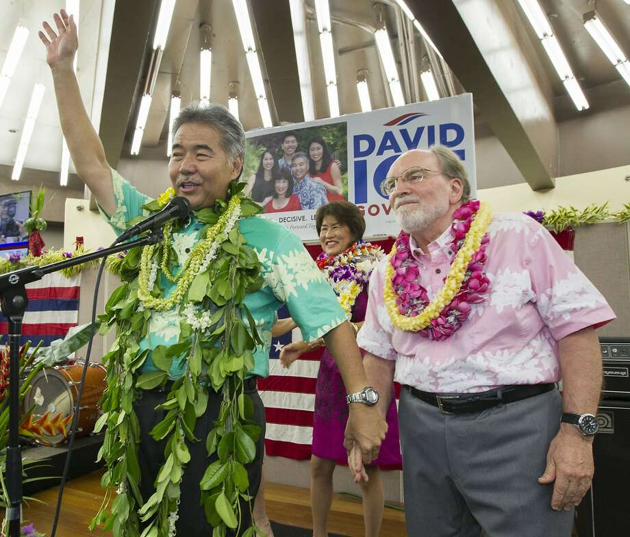 State Sen. David Ige (left) waves to supporters and thanks Gov. Neil Abercrombie, who promised his support in the election. Photo: Eugene Tanner, Associated Press