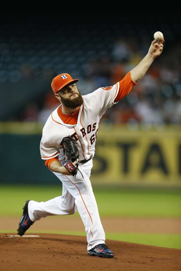 August 10: Rangers 6, Astros 2  Dallas Keuchel pitches during the first inning. Photo: Karen Warren, Houston Chronicle