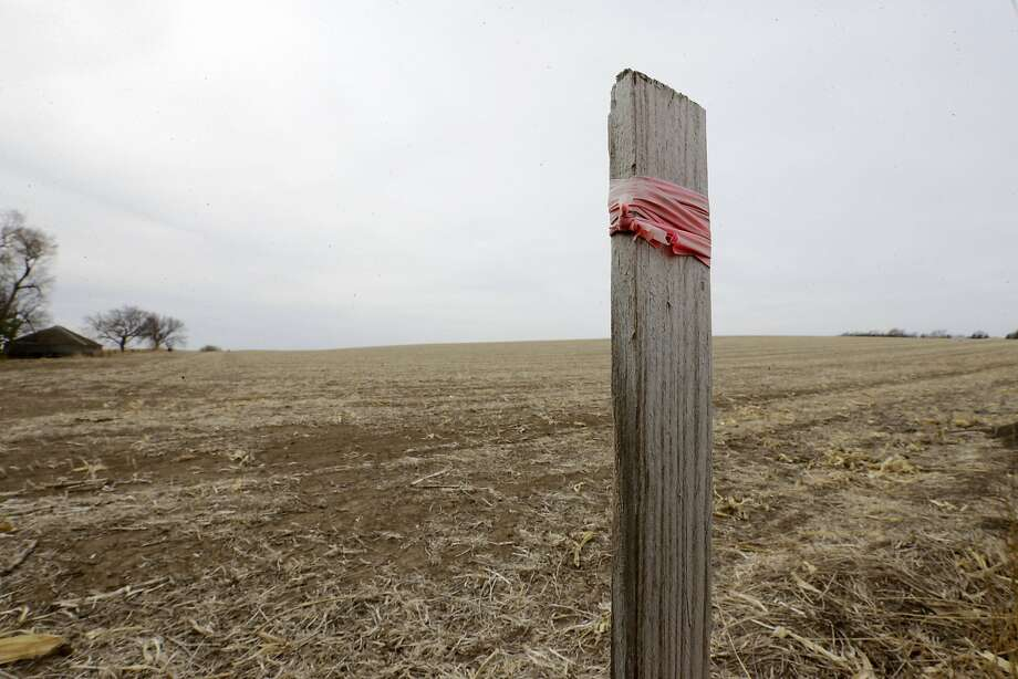 This stake in the ground marks the planned route of the Keystone XL pipeline in Tilden, Neb. The controversial project could produce four times more global warming pollution, a study says. Photo: Nati Harnik, Associated Press