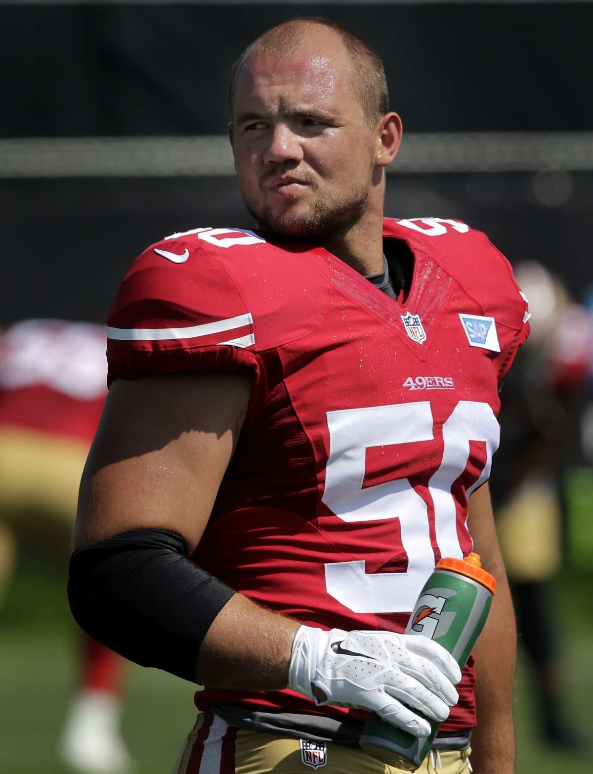 Linebacker Chris Borland stays cool during the San Francisco 49ers training camp in Santa Clara, Calif. on Tuesday, July 29, 2014.