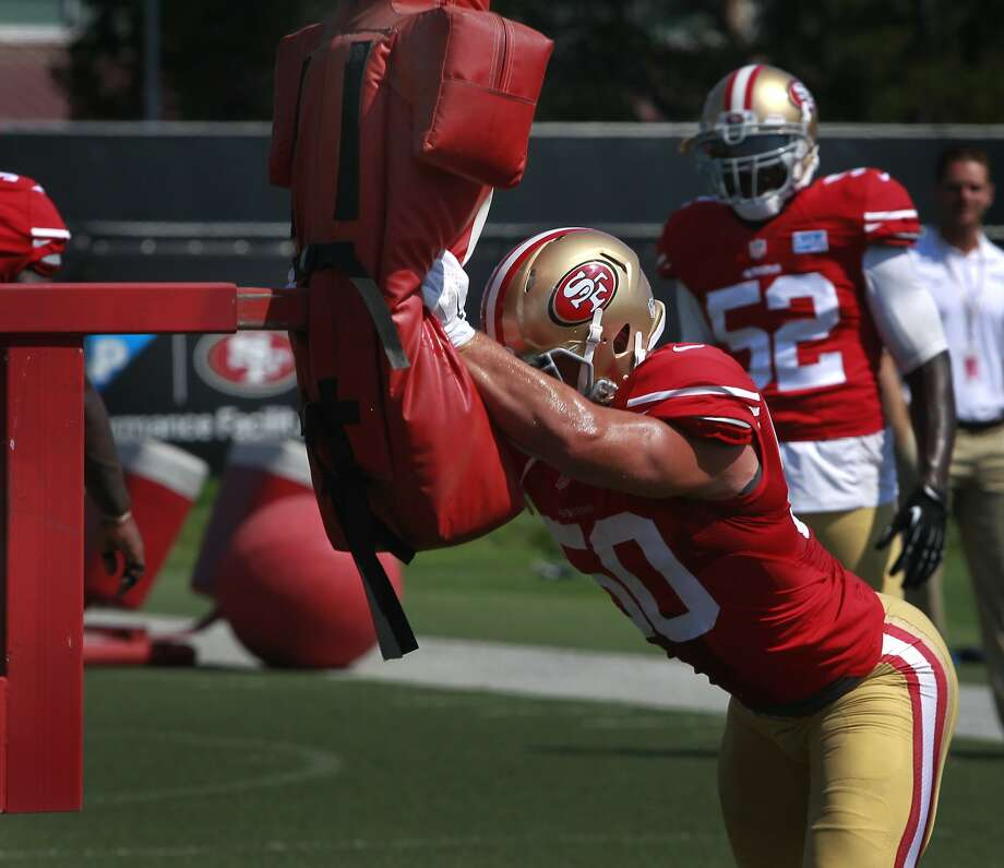 Linebacker Chris Borland hits a blocking sled during the San Francisco 49ers training camp in Santa Clara, Calif. on Tuesday, July 29, 2014. Photo: Paul Chinn, The Chronicle