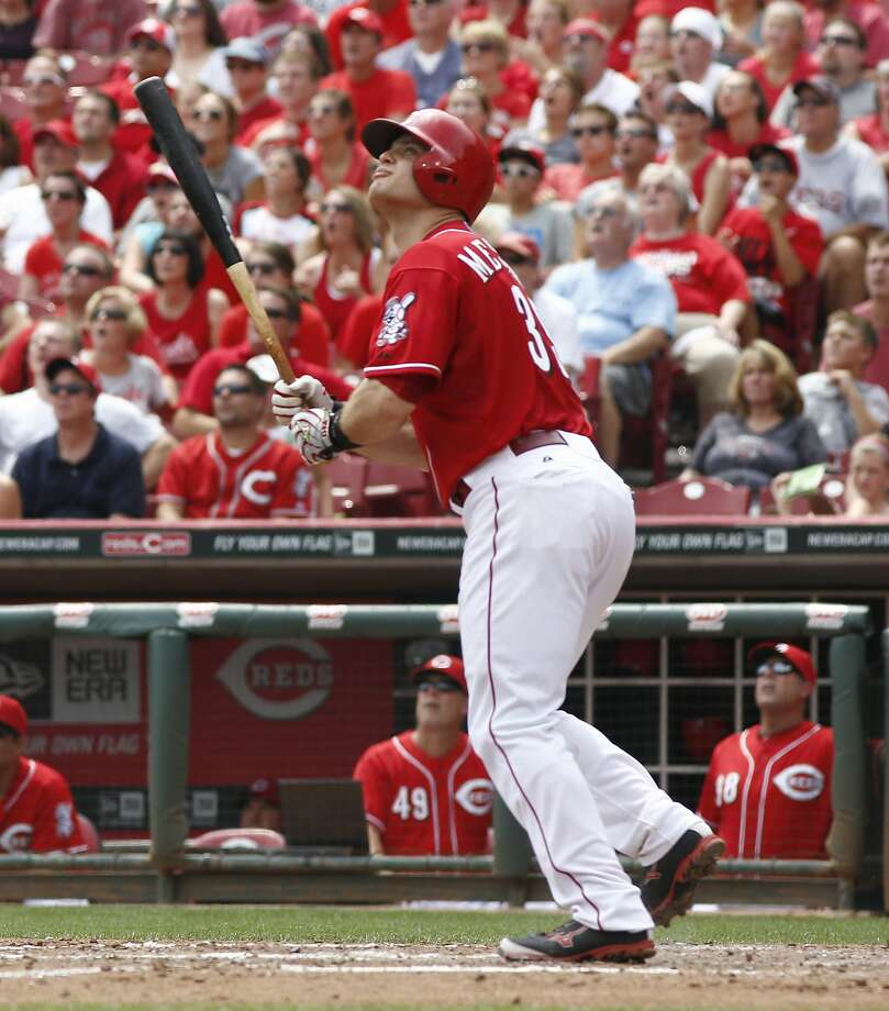 Cincinnati Reds' Devin Mesoraco watches his grand slam  homer off Miami Marlins starting pitcher Brad Hand in the fifth inning of a baseball game, Sunday, Aug. 10, 2014, in Cincinnati. (AP Photo/David Kohl) Photo: David Kohl, Associated Press