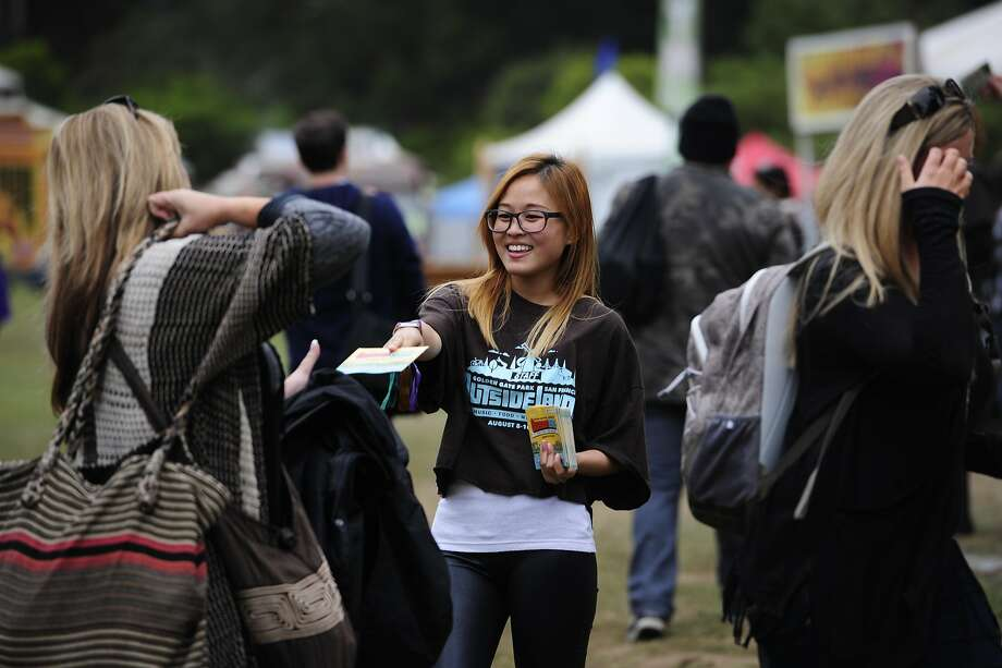 Louise Chang hands out maps to attendees at Outside Lands Music Festival in Golden Gate Park on August 10, 2014 in San Francisco, CA. Photo: Craig Hudson, The Chronicle