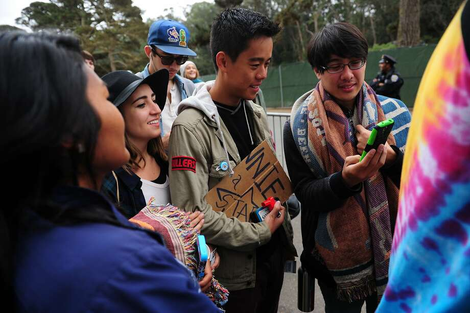 From left, Inez Im, Sarah Edwards, Andrew Vinksi and Felix Perez wait in line at Outside Lands Music Festival in Golden Gate Park on August 10, 2014 in San Francisco, CA. Photo: Craig Hudson, The Chronicle