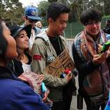 From left, Inez Im, Sarah Edwards, Andrew Vinksi and Felix Perez wait in line at Outside Lands Music Festival in Golden Gate Park on August 10, 2014 in San Francisco, CA.